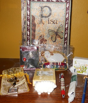 Inside the lovely wooden box: Mary Queen of Scots necklace, sheep ornament, Treasuring Theresa keychain in bag, bar of soap, bath crystals, sheep soap, pen, pencil, Castles and Palaces of Scotland playing cards