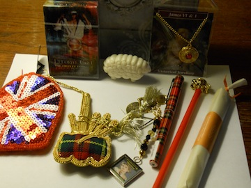 Lovely wooden box, 2013 Ellora's Cave playing cards (for adults only), sheep soap, James I and II necklace, Union Jack sequined coin purse, plaid bagpipes Christmas ornament, Treasuring Theresa key chain, plaid pen, crown pencil, fizzing bath crystals