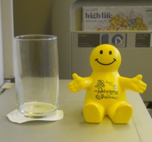 Squidgeworth enjoyed his orange juice on the plane.