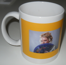 Choice of a Susana Ellis mug or a Susana Ellis portfolio (notepad)