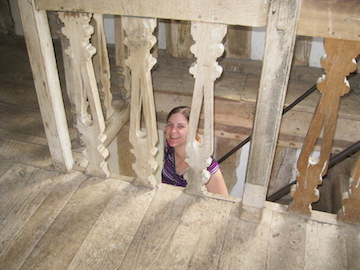 Author Cora Lee coming up the stairs of the gatehouse